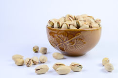 Pistachio nut. In a bowl stock photography