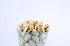 Pistachio nut. In a cup stock photos