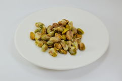 Pistachio nut peel out on dish Royalty Free Stock Image
