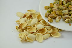 Pistachio nut peel out on dish Stock Photo