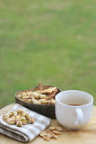 Pistachio nut and white coffee cup. Stock Images