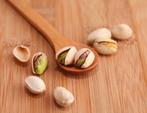 Pistachio nut on wood background Stock Photography