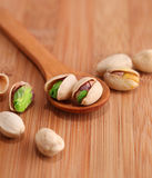 Pistachio nut on wood background Royalty Free Stock Photo