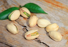 Pistachio nut on wood background Stock Images