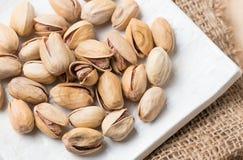 Pistachio nut on wood background Stock Photo