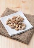 Pistachio nut on wood background Royalty Free Stock Image