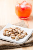 Pistachio nut on wood background Stock Photos