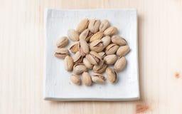 Pistachio nut on wood background Stock Images