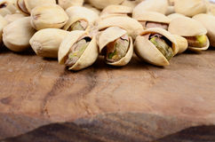 Pistachio nut. On a wooden board stock images
