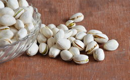 Pistachio nut on wooden board Royalty Free Stock Image