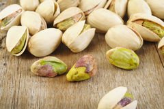 Pistachio nut on wooden table background Stock Photos