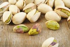 Pistachio nut on wooden table background Stock Photos