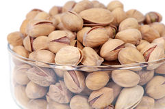 Pistachio nuts. Close up view of phistachio nuts in the glass bowl Royalty Free Stock Photos