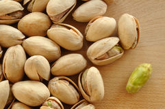 Pistachio Nuts. Close-Up of Pistachio Nuts on a Cutting Board Stock Images