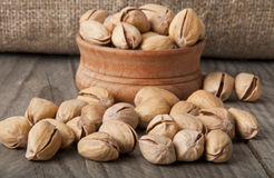 Pistachio Nuts. Cracked and Dried Pistachio Nuts In A Wooden Bowl Stock Images