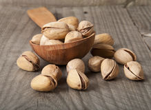 Pistachio Nuts. Cracked and Dried Pistachio Nuts In A Wooden spoon Stock Image