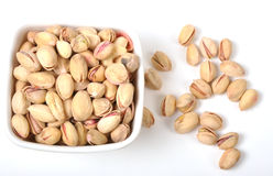 Pistachio nuts. Bowl of Pistachio nuts on isolated white Royalty Free Stock Photo