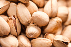 Pistachio nuts. A handful of pistachio nuts, healthy snack royalty free stock photography