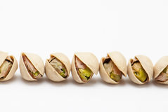 Pistachio nuts. On white background Royalty Free Stock Photo