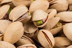 Pistachio nuts arranges as background Stock Image