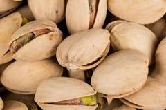 Pistachio nuts arranges as background Royalty Free Stock Photos