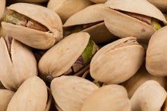 Pistachio nuts arranges as background Stock Photography