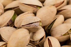 Pistachio nuts arranges as background Royalty Free Stock Image