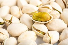 Pistachio nuts arranges as background.  royalty free stock photo