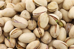 Pistachio nuts background Stock Photos
