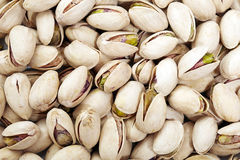 Pistachio nuts background Stock Photo