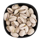 Pistachio nuts in bow, isolated.  Pistacia vera. Stock Photos
