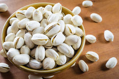 Pistachio nuts in a bowl Royalty Free Stock Images