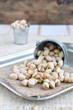 Pistachio nuts in a bucket Royalty Free Stock Photography