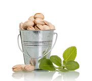 Pistachio nuts in a bucket Stock Images