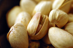 Pistachio Nuts (Close Up). A close up shot of some pistachio nuts still in their shells Stock Photos
