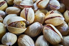 Pistachio nuts in a close-up, macro. Pistachio nuts - large close-up macro. A healthy and tasty snack stock photo