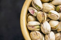 Pistachio nuts closeup with shell stock photos