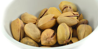 Pistachio Nuts in cup Stock Images