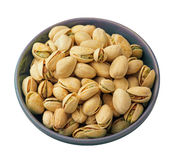 Pistachio nuts in dish isolated background Stock Photos