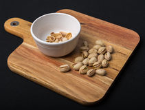 Pistachio Nuts and Empty Shells on Serving Board Royalty Free Stock Photography