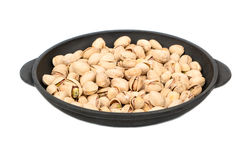 Pistachio nuts in frying pan Royalty Free Stock Images