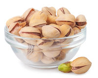 Pistachio nuts in glass bowl Stock Image