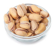 Pistachio nuts in glass bowl top view Royalty Free Stock Images