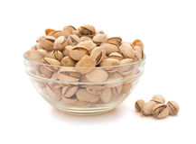 Pistachio nuts in a glass bowl Royalty Free Stock Photography