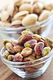 Pistachio nuts in glass bowls Stock Images