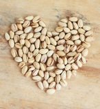 Pistachio nuts in heart shape Royalty Free Stock Image