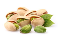 Pistachio nuts with leaves. In closeup Stock Photos