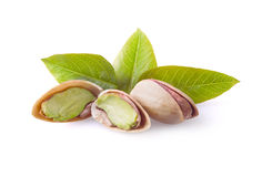 Pistachio nuts with leaves. Royalty Free Stock Image