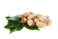 Pistachio nuts with leaves Stock Images