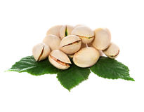 Pistachio nuts with leaves Royalty Free Stock Images